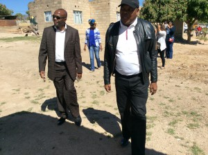 Kgosi Thobejane with Dr. Mahapa conducting an inspection of houses built for Military Veterans in Acornhoek, Mpumalanga